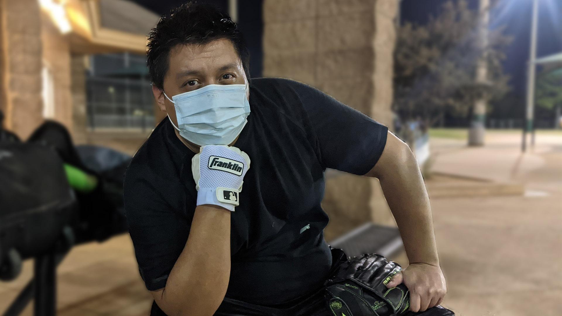 Dante Ramos-Delgado poses for a photo at the softball fields.