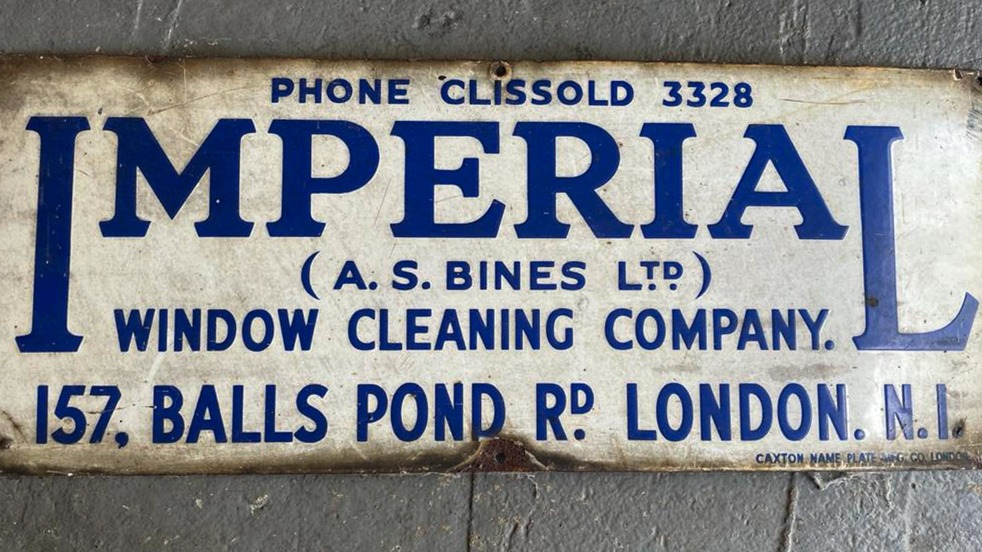 A sign for North London Plant Hire's original window-cleaning business